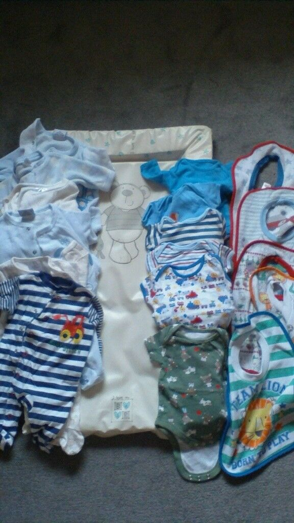 Baby changing mat, 6 x babygrows, 6 x vests and 5 x bibs
