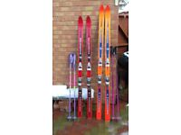 1-STRATOFLEX 185cm Skis with poles 1-CONCORDE 175cm Skis with poles and bag.