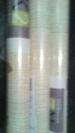 3 x rolls of neutral wood effect wallpaper