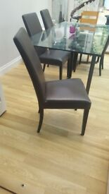 Modern glass dining room table and 4 leather chairs originally from John Lewis