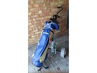 Full set of golf clubs, irons and woods plus bag and trolley.