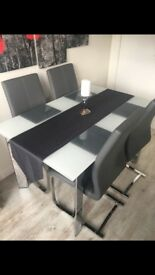 Barker and stone house glass dining table