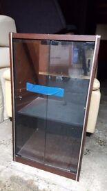 Small glass cabinet.