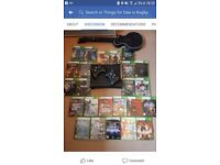 Xbox 360 + 24 games + 2 controllers + guitar