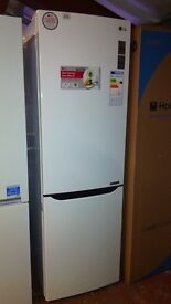 LG fridge freezer, slightly marked