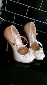 4 pairs size 7 high heels