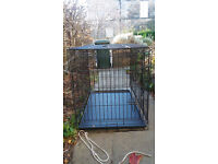 Black plastic coated dog cage; medium sized dog e.g. border collie