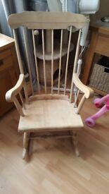 Stripped pine rocking chair.