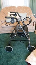 4 wheeled walking frame with soft chair and shopping bag