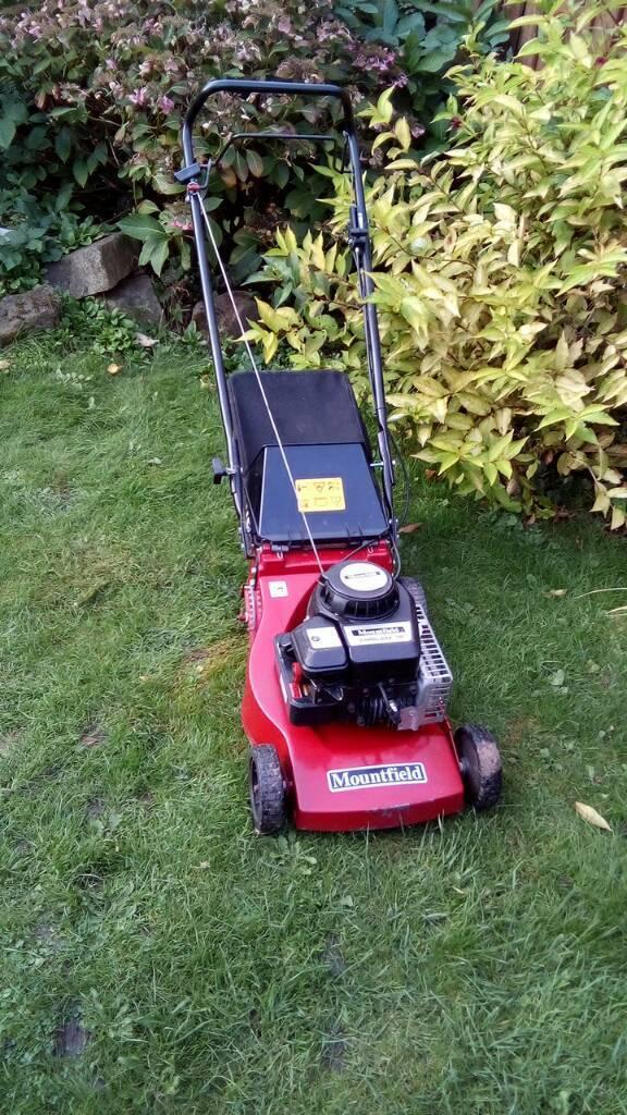 Mountfield petrol mower in working order one wheel missing