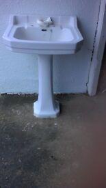 White bathroom sink on a pedestal