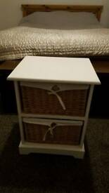 White storage unit with two wicker baskets