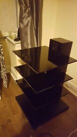 Black tv stand with black smoked glass shelves