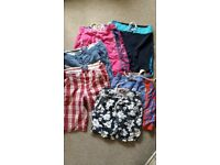 selection of superdry and animal shorts and swimwear.