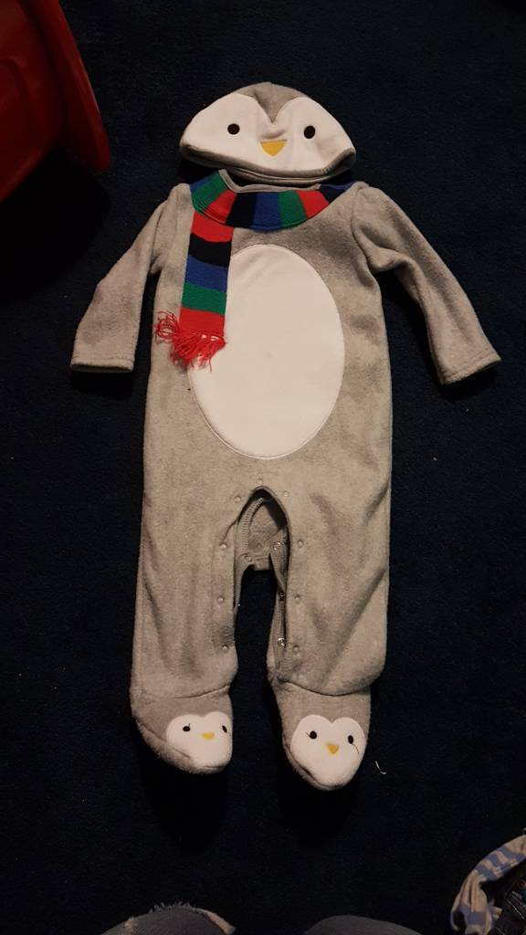 Penguin Christmas sleepsuits 6-9 months.