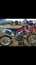Motocross bike for sale need gone asap in mint condishon only been used 2 times since had it