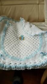 Handmade crocheted babys pram cover