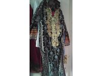 Asion women clothes size 10,12.some stitch used but good condition some unstitch