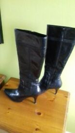 black leather high heel boots size 3 only worn a few times .