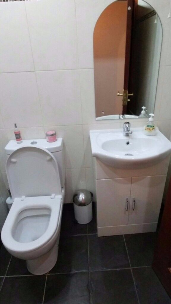 White toilet and vanity unit including taps