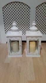 2 beautiful white lanterns
