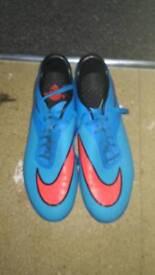 Blue nike hypervenom football boots