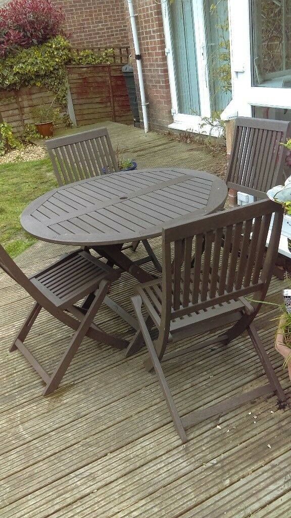 Solid Teak Garden Table and Four chairs ... good condition ...