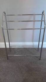 Free-standing towel rail with shelf