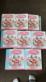cake decorating collection with large box of utensils.