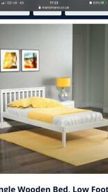 Single white wooden bed
