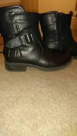 Black imitation leather boots