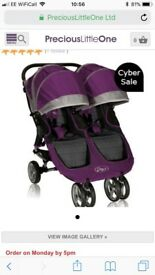 Purple double baby jogger