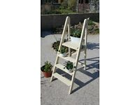 Vintage wooden step ladder for displaying plants, looks lovely with candles in the evening