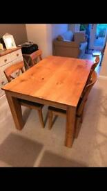 Solid oak table (chairs not included)
