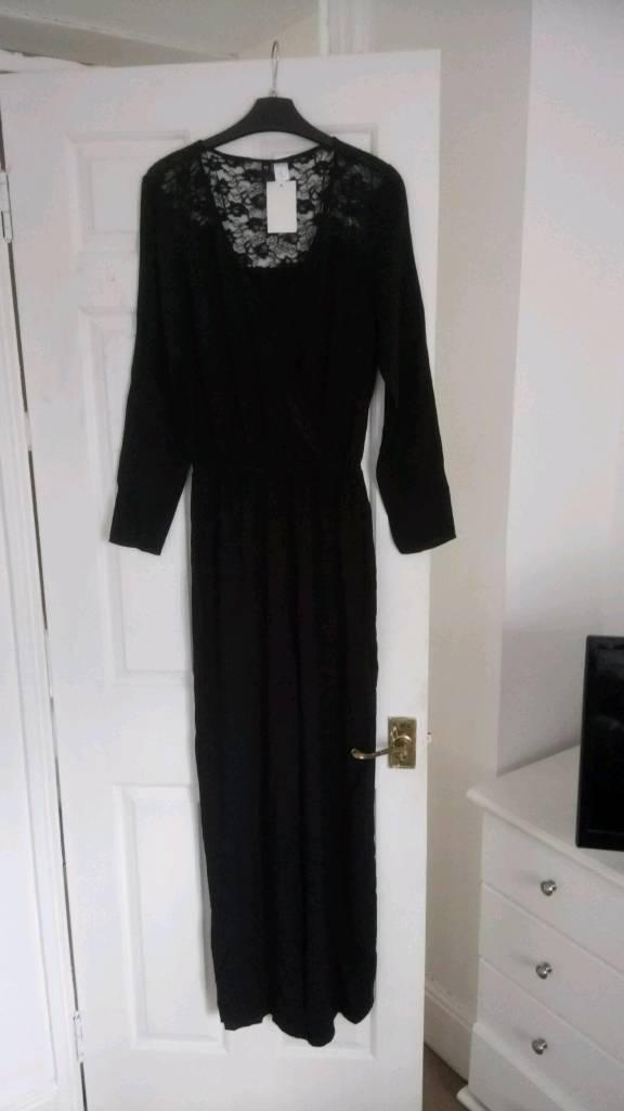 Black lace jump suit size 12