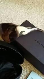 Prada Sunglasses with all original packaging and reciept