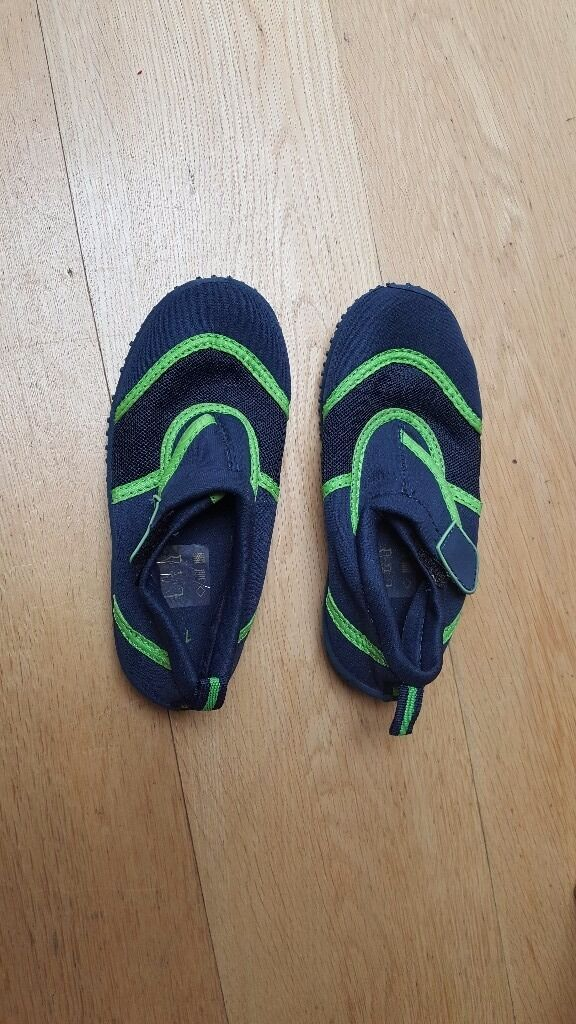 Blue and green childrens beach shoes size 11in Brighton, East SussexGumtree - childrens beach shoes Perfect for UK beaches Good grip on base for walking on pebbles Child can go swimming wearing these shoes Navy blue with bright green trim Velcro strap to take on/off Breatheable mesh section Size 11