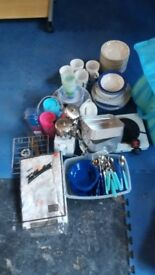 cool bag full of dishes mugs cutlery kettle toaster etc
