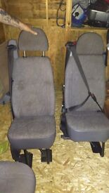 Two single over wheel arch seats