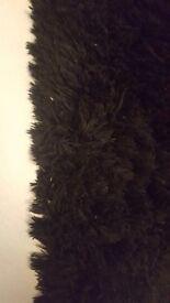 Black shaggy thick rug