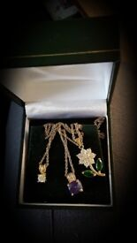 Box of gold plated necklaces