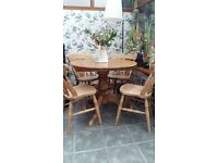 Farmhouse dining table and four chairs.