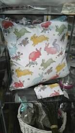 Bunny and gingham feather cushion