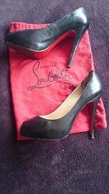 Balck classic. Christian Louboutin, stiletto, peep toe. Size 39
