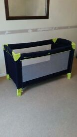 Mama's and Papa's Travel cot. Dark Blue with green feet/wheels and corners
