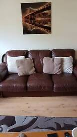 Brown leather 3+2 seater sofas