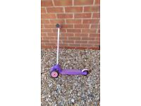3 wheeled purple scooter