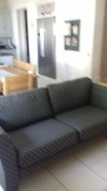 Excellent fashionable charcoal grey sofa.