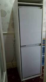 Tall integrated fridge freezer with housing unit