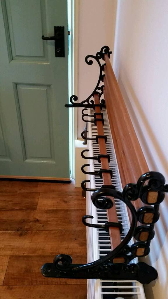 Cast iron hanging pan rack
